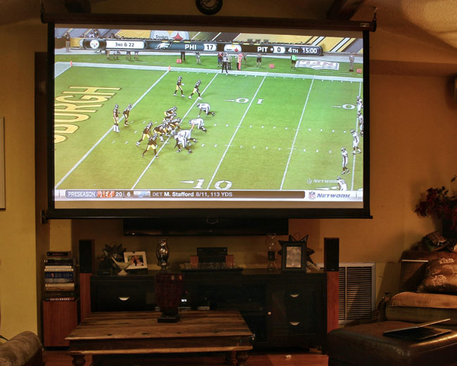 Projectors vs tvs should you ditch your flat screen for a for What size tv do i need for a 12x15 room