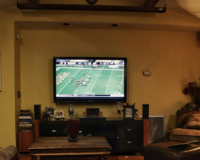 Projectors vs tvs should you ditch your flat screen for a for Living room with 65 inch tv