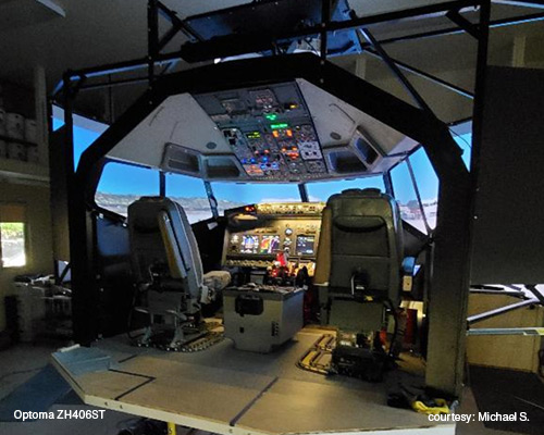 view of flight simulator with Optoma ZH406ST model projectors used as displays